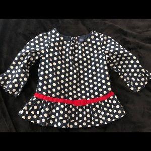 Super cute polka dot peplum shirt